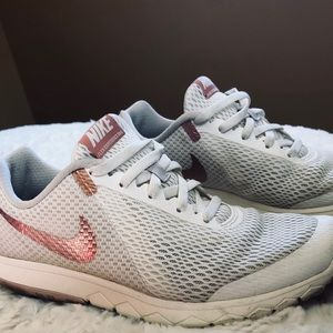 Nike rose gold running shoe